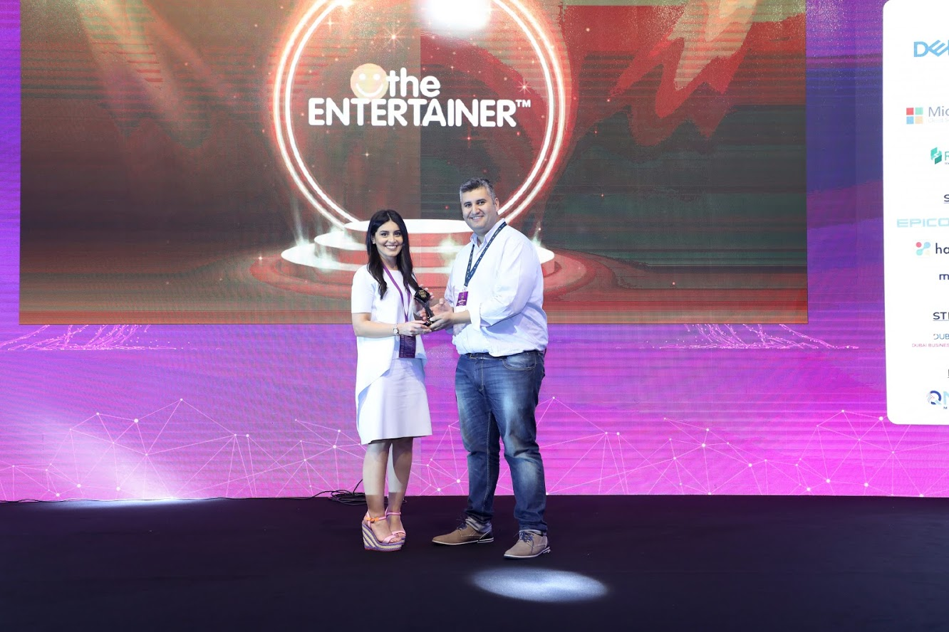 Rana Al Najjar, Marketing Manager accepts the award for 'Best Customer Loyalty App of the Year'